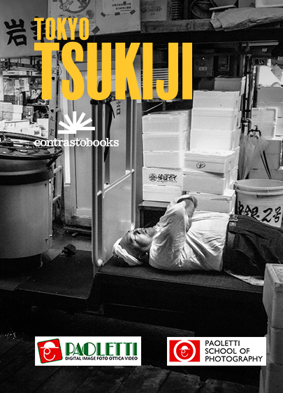 Official poster of the exhibition dedicated to Tokyo Tsukiji by Nicola Tanzini that will be held in Bologna at Paoletti Foto, Galleria Cavour. The photo represents a worker of the market sleeping on a cart at the end of the working day.