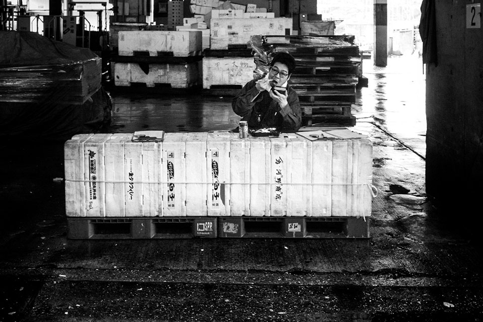 "Black and white photos of the book ""Tokyo Tsukiji"" by Nicola Tanzini."